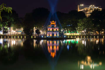 Tower of the Turtle on the lake of the Returned Sword in night illumination. Historic center of Hanoi