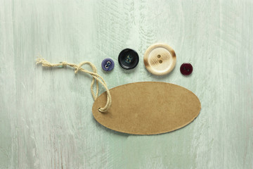 Kraft cardboard tag with twine and retro buttons