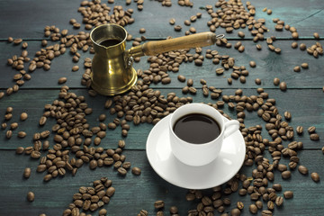 Coffee cup and pot with scattered grains