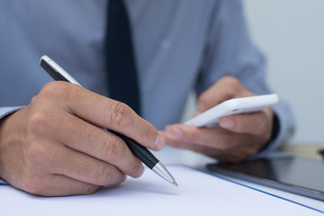 Businessman writing on note pad