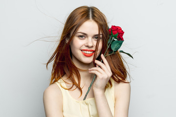 pretty woman with an artificial flower