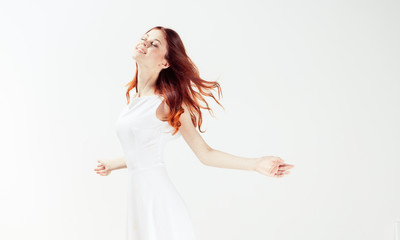 light background and woman with red hair