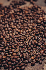 scattered coffee beans wooden table