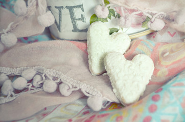 Cookies in the shape of hearts on the textiles background. Boho style. Love concept background. February 14 Holidays. Happy valentines day celebration