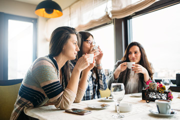 Female friends enjoy in coffee at cafe bar