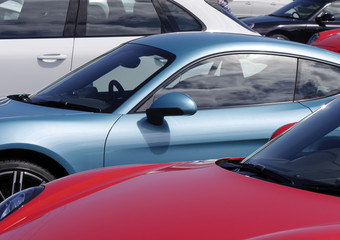 Sports cars in parking lot