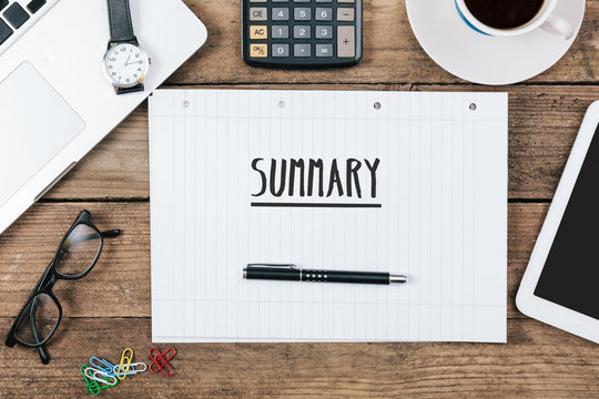 summary on notebook on Office desk with computer technology, hig