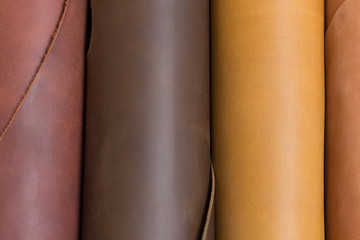 Brown and light brown leather rolls,