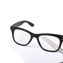 Reading glasses over a notebook