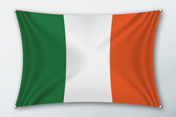 Ireland national flag. Symbol of the country on a stretched fabric with waves attached with pins. Realistic vector illustration.