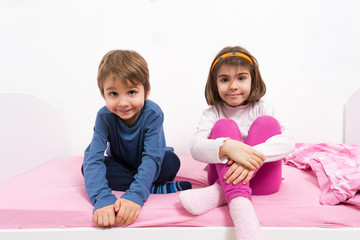 Kids sitting in bed