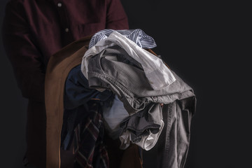 Man holding clothes