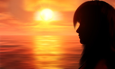 Silhouette of a face of a woman on the beach at sunset