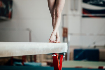 feet young girl athlete gymnast on balance beam