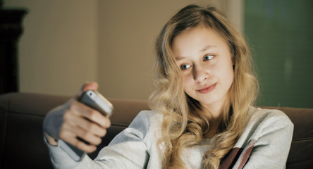 Selfie portrait, girl with smart phone