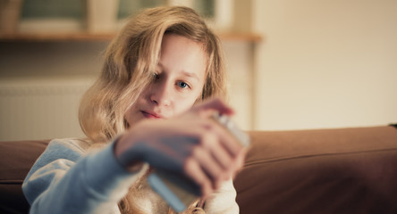 Happy teenager girl take selfie portrait using cellphone