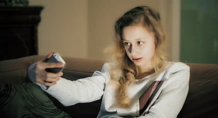 Girl takes self portrait using smartphone app