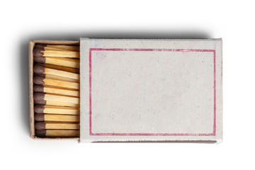 Matches isolated on white background. Closeup shot.