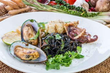 Black spaghetti Alle Vongole. Black seafood pasta with clams and
