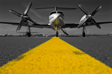 Color key picture of a Piper Cheyenne IV parked on the apron waiting for passengers.