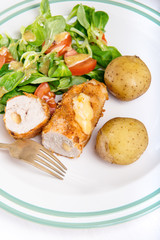 Kiev cutlet with jacket potatoes and salad