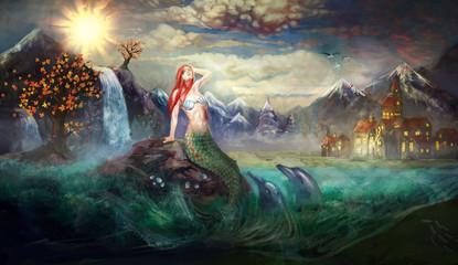 mermaid on rock in the sea