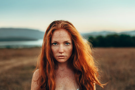 Portrait of redhead woman outdoors