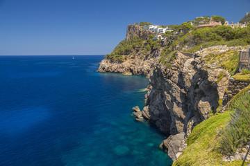 cliffs coastline with calm deep blue sea
