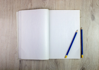 Layout. a notebook, a pencil for drawing on a table.