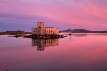 Poster Candy pink Kisimul Castle on Barra in the Outer Hebrides of Scotland is a formidable fortress founded in 1039 and situated on an islet facing the village of Castlebay.