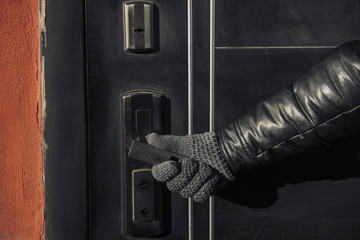A man holds the door handle