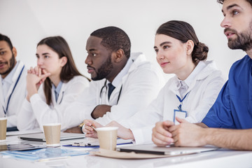Outgoing doctors listening lecture at conference