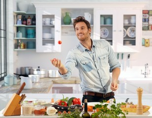 Young man having fun in kitchen