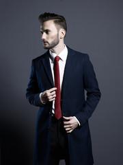 Handsome stylish man in autumn coat
