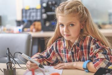 Interested girl in light workshop