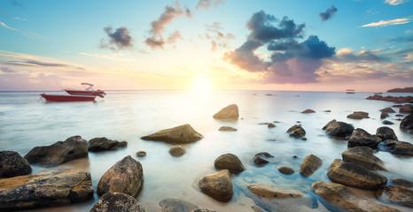 Barques au coucher de soleil