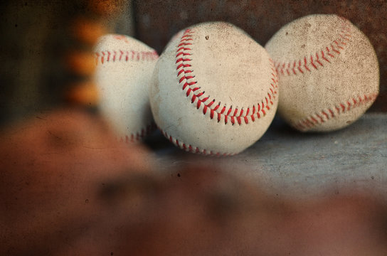 Baseballs through the eye of the glove, rustic vintage balls for background or graphic elements.