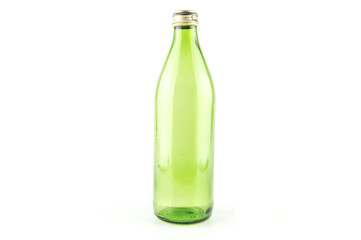 Glass empty green bottle isolated on a white background