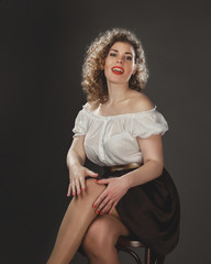 Girl in the style of Marilyn Monroe, pin-up style, Studio photography in artistic treatment