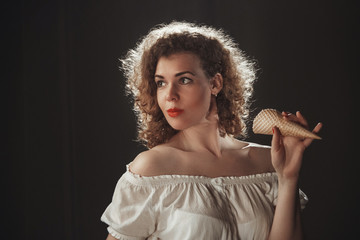 Girl in the style of Marilyn Monroe, pin-up style, hands holding ice cream, Studio photography in artistic treatment