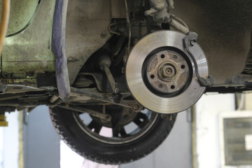 Car on a lift in a car repair station