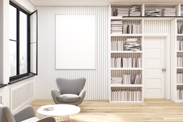 Home library with gray armchairs