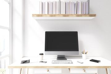 Computer monitor and a bookshelf