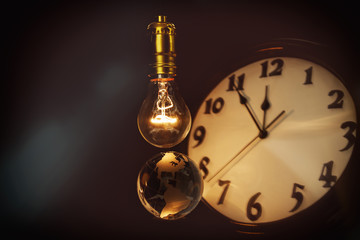 Light bulb, earth and clock
