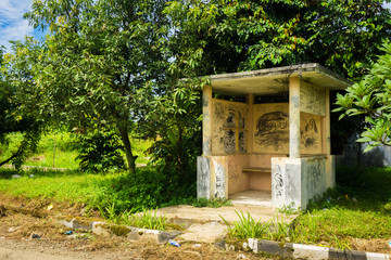 An abandoned security pos surrounding with grass and bushes photo taken in Dramaga Bogor Indonesia
