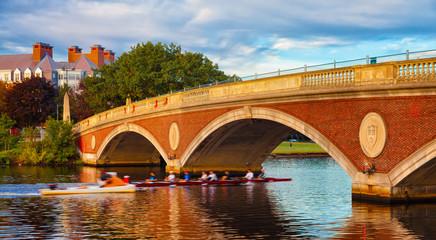 Harvard University scull team rowing practice. Motion blur going under bridge.