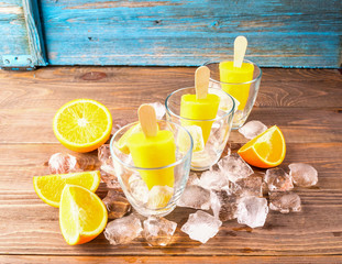 Summer Popsicles or orange juice frozen a stick