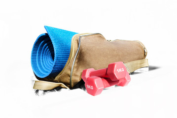 Mat for fitness and fitness pink dumbbells isolate on a white background