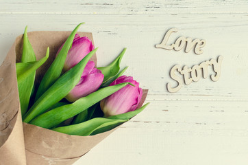 Tulip flowers with wooden words LOVE STORY