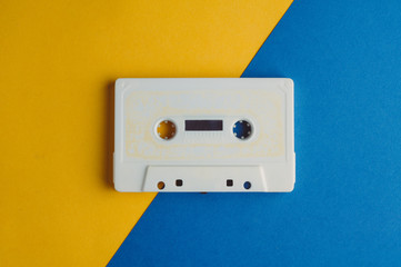 Old audio tape on a blue yellow background. Music concept
